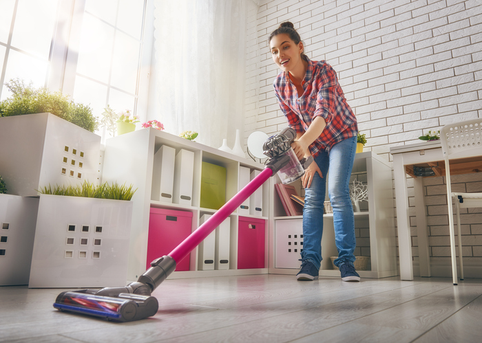 woman with HEPA vacuum cleaner